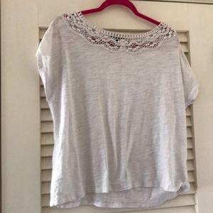 White tee with crocheted neckline size XL.